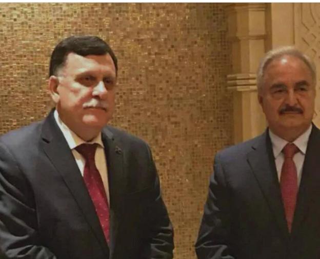 Photo of Libia: Serraj firma l'accordo a Mosca, Haftar chiede più tempo